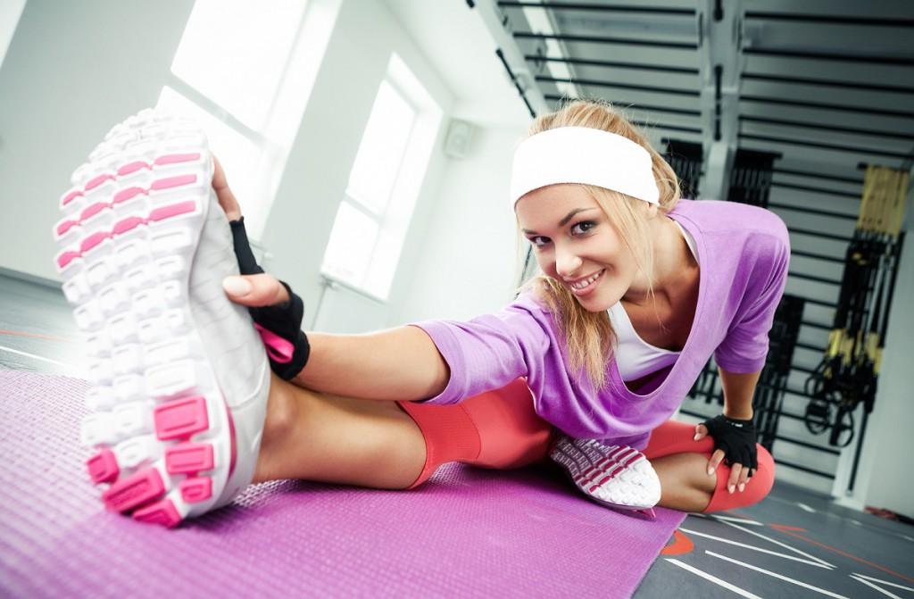Ausgiebiges Dehnen schützt vor Muskelkater