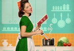 Retro Smiling Woman Cooking And Reading Recipe Book In Her Kitch